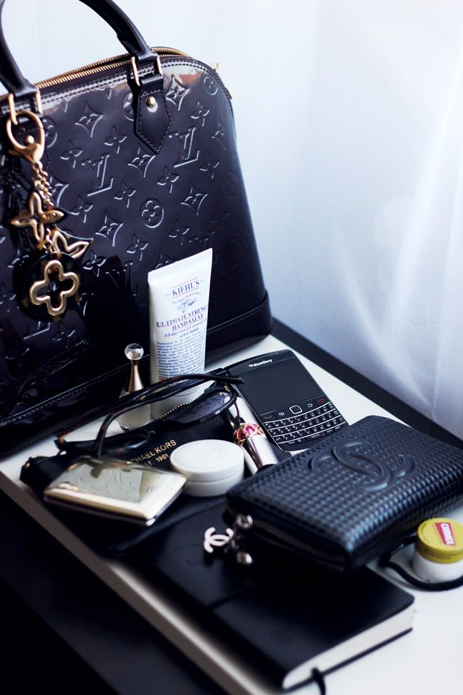 LV Alma, Chanel zip wallet, BB, chapstick, black ponytail holder, and notepad - wish that wallet was in that bag I wish I had.