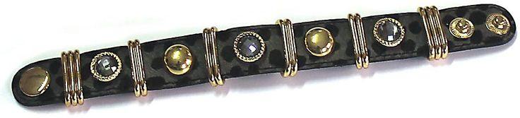 braccialetto in cuoio maculato con borchiette