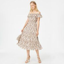 """With off-the-shoulder ruffles in an airy, super soft silk, the Hamisi evokes a restrained bohemian air paired with modern femininity. Silk; lining: polyester Relaxed fit 49"""" in length, based on a size 6 Elasticized off-the-shoulder ruffled neckline; elasticized waist; tiered skirt with ruffles Dry clean Imported"""