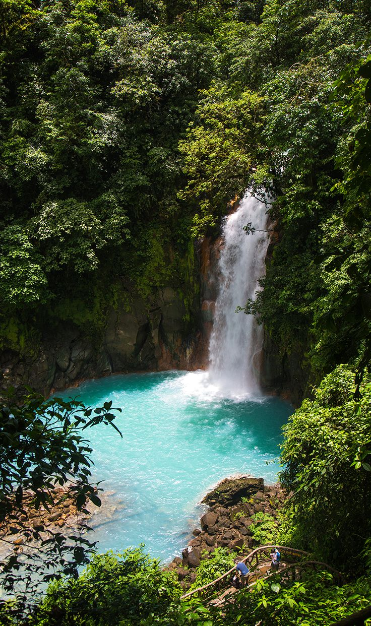 The beautiful waterfall of Rio Celeste, a sky blue river in Northern Costa Rica. Click through to read our guide on visiting this amazing spot http://mytanfeet.com/activities/tips-visiting-rio-celeste/