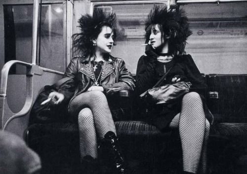 Two punk girls on the Tube, 1980s London.