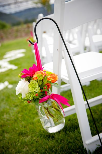 A cute and cheap way to line the aisle, especially for where you want to do it at. Works well with the garden theme.