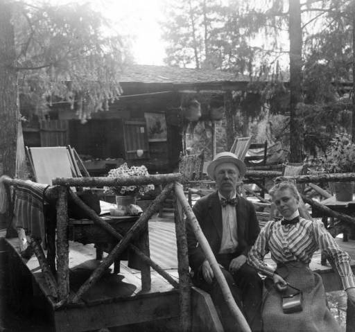 Mary Byers Robinson and Mr. Robinson outside of their log cabin in Ferndale, CO circa 1900-1910.