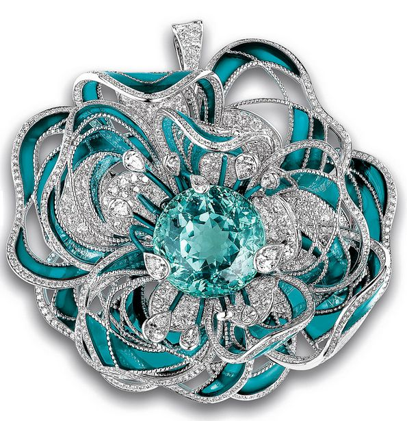 Chanel camellia brooch with Paraíba tourmaline.inspired by a single rare stone: a 38-carat, blue-green Paraiba tourmaline, which in the brooch is encircled by diamonds and sea-blue enamel.