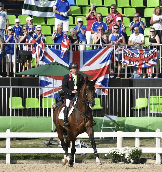 Britain's Nick Skelton on his horse Big Star rides with his gold medal after…