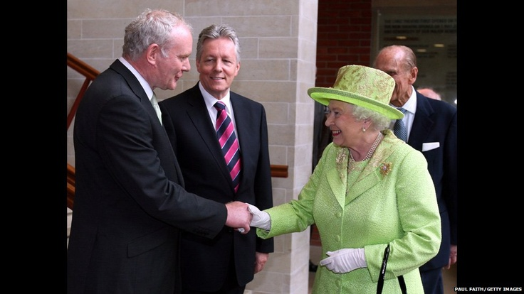 Queen Elizabeth II and former IRA commander Martin McGuinness shake hands for the first time, in what is being seen as a ground-breaking moment in Anglo-Irish history. Mr McGuinness is now Northern Ireland's deputy first minister.