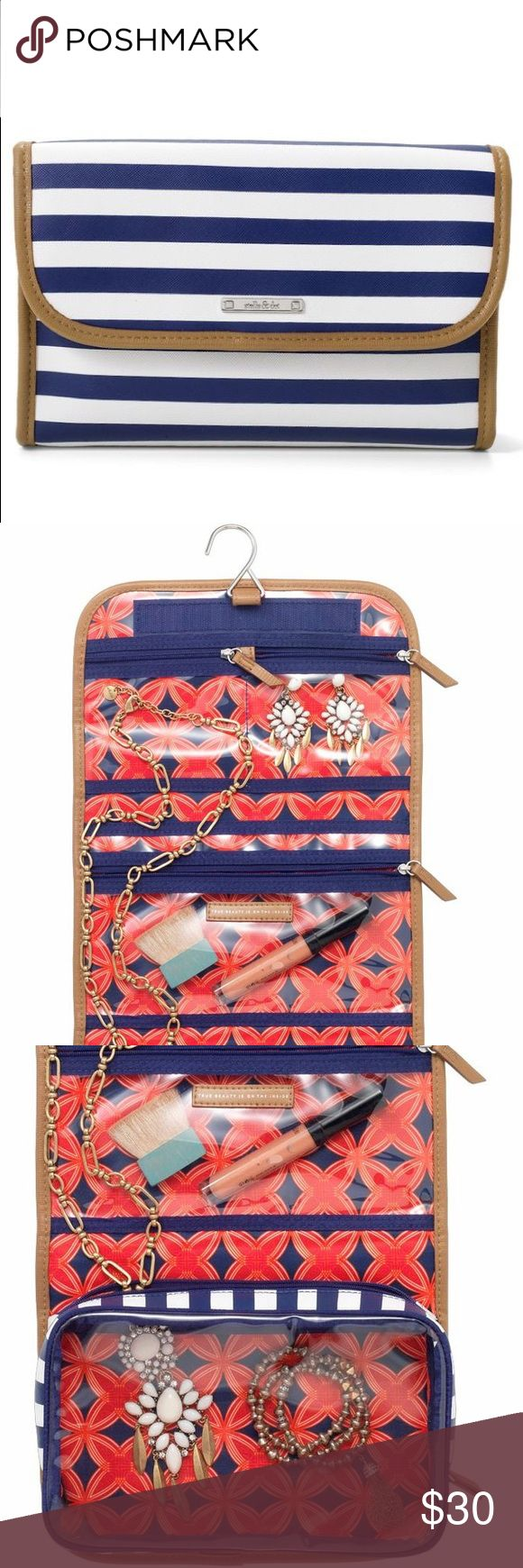 """Stella & Dot Hang On Travel Case Navy and white travel case - has hanger to hang up and lots of pockets to store makeup, jewelry and other travel essentials. Durable construction and timeless pattern! Gently used, although it looks new - I even left the protective covering on the S&D nameplate. Measures 91/2"""" X 6 1/2"""" folded, 9 1/2"""" X 19 1/2"""" unfolded Stella & Dot Bags Cosmetic Bags & Cases"""