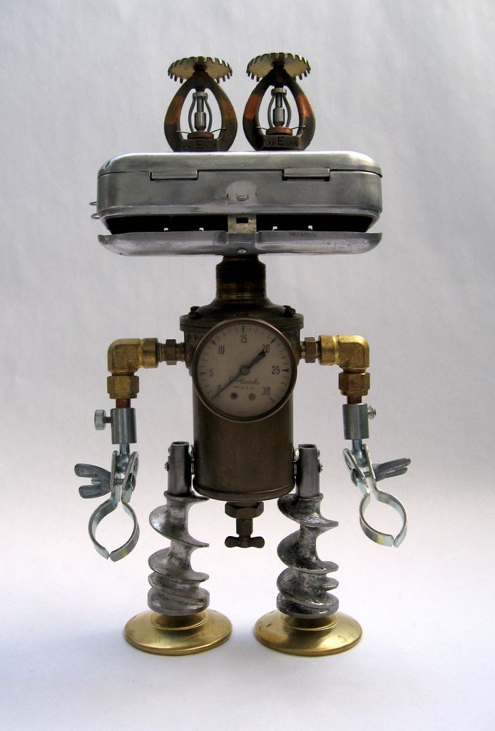 Robot sculpture assembled from found objects by Brian Marshall - Wilmington, DE.  Items included in my sculptures vary from vintage household kitchen items to recycled industrial scrap.  Some of my favorite items to use are old oil cans, aluminum measuring spoons, electrical meters, retro blenders, anodized cups, and pencil sharpeners.