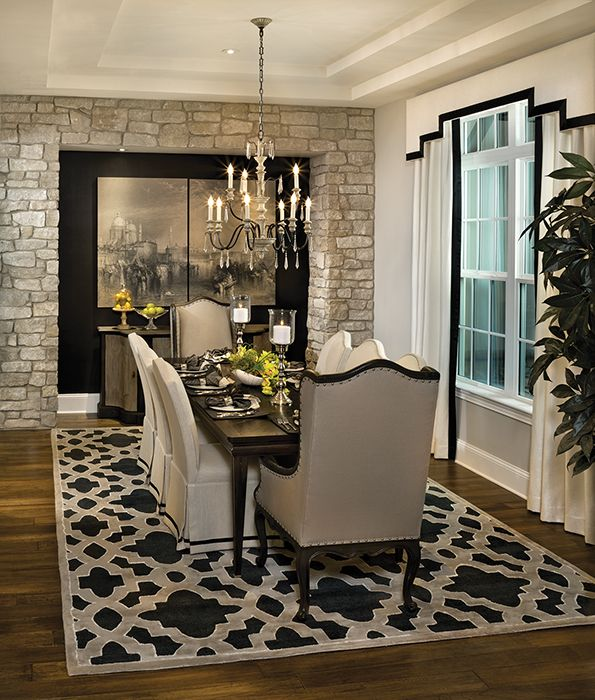 A stone wall in a dining room adds drama and can create a for Homes without dining rooms