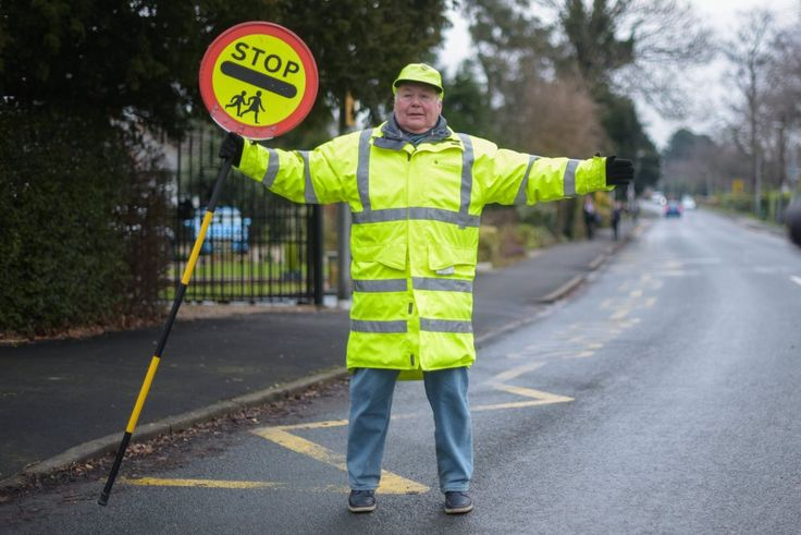 """A veteran lollipop man who says he felt forced to quit his job after parents complained he was 'high-fiving' schoolkids has today blamed """"political correctness gone mad"""".    Award-winning Bryan Broom, 77, claims he was told by"""