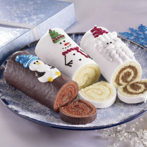 Cake with butter creme topping, rolled and covered with chocolate. Love the hand-decoration!