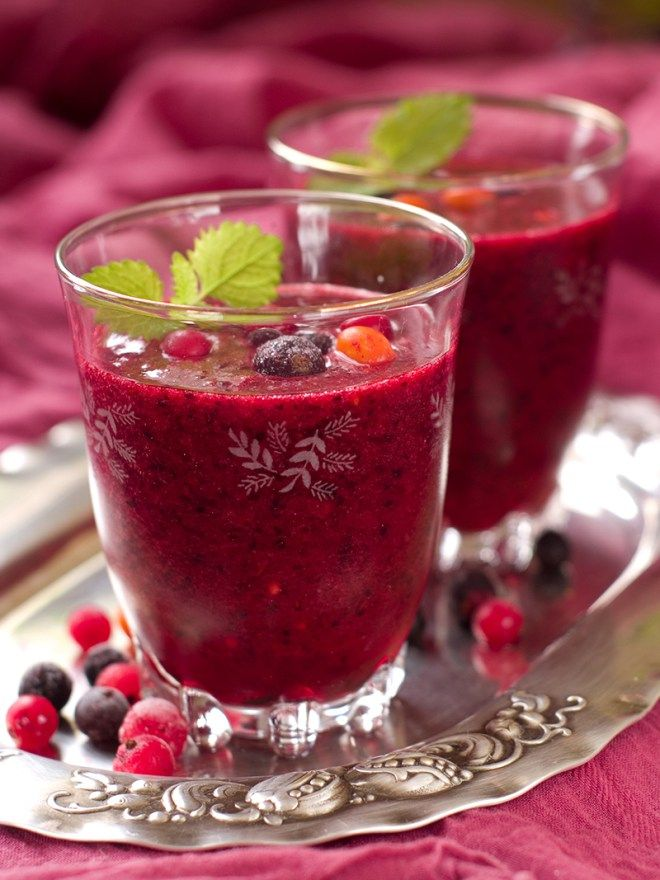 Berry smoothie with red and black currant, cranberry, cow berry, strawberry, selective focus