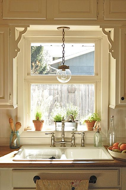 Kitchen sink--sweet, old-fashioned look. Love the light fixture.