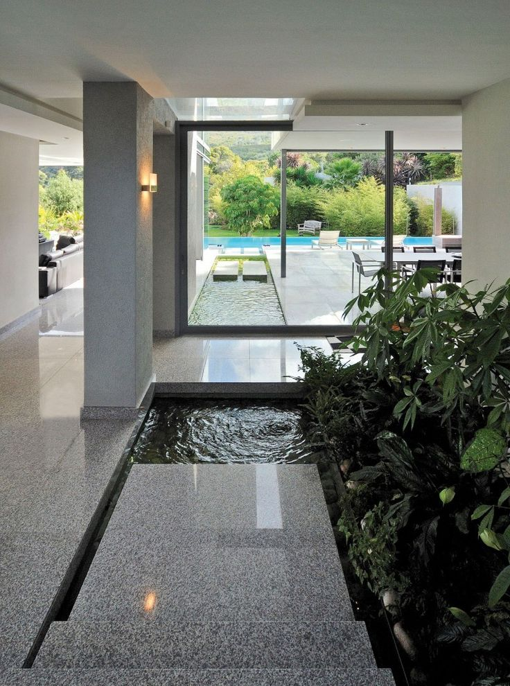 Beautiful grey granite flooring with small pond and indoor artifical plantation.