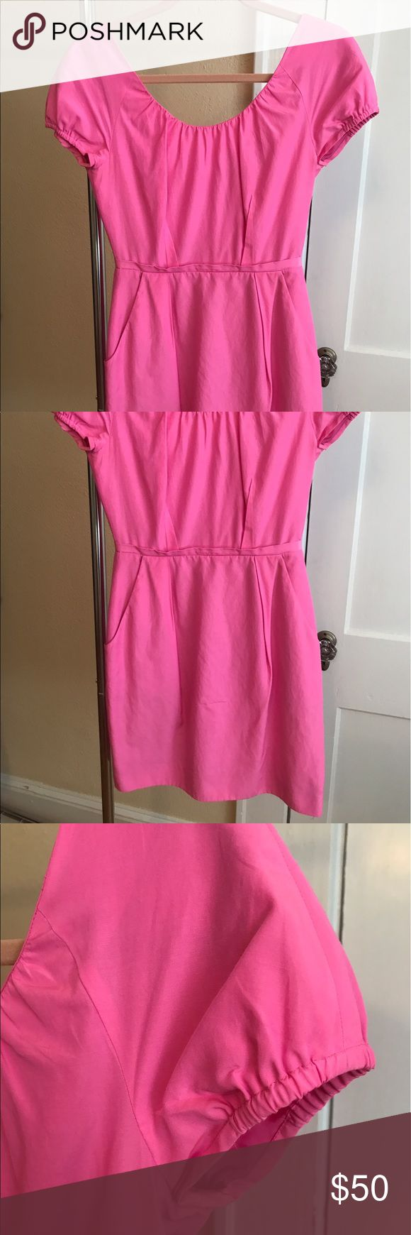 J. Crew Neon Pink Party Dress This J. Crew neon pink dress is perfect for a summer party! It has fun details like an exposed zipper and pockets to hold your lipstick or cell phone! Size 0. Dry clean only. J. Crew Dresses