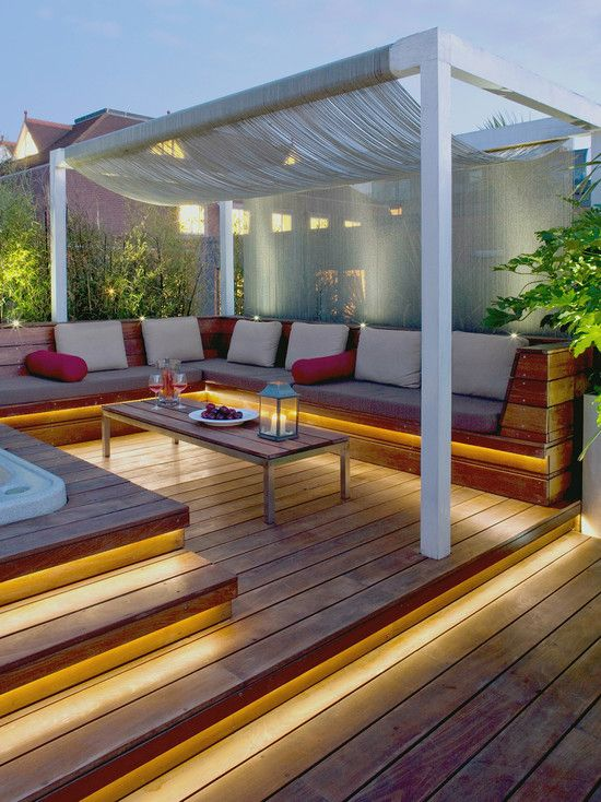 Maximizing the Pergola Landscaping Ideas to Establish the Purposeful Building: Tropical Deck With Captivating Pergola Roof Covering Also Cool Hiding Lamp With Floorboard ~ kitchentablecomics.com Garden Ideas Inspiration