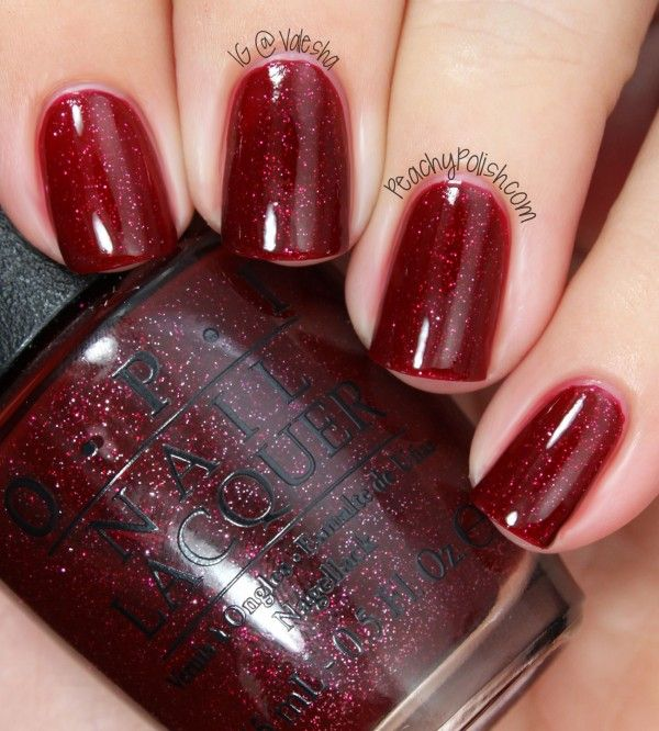 """OPI: Mariah Carey Holiday 2013 Collection Swatches """"Underneath The Mistletoe"""" is a silver and red microglitter filled red jelly"""