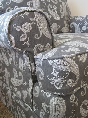 This lady makes slip covers for chairs. I'm having one heck of a time finding some cool chairs for not to much. Maybe I will have to try this out.