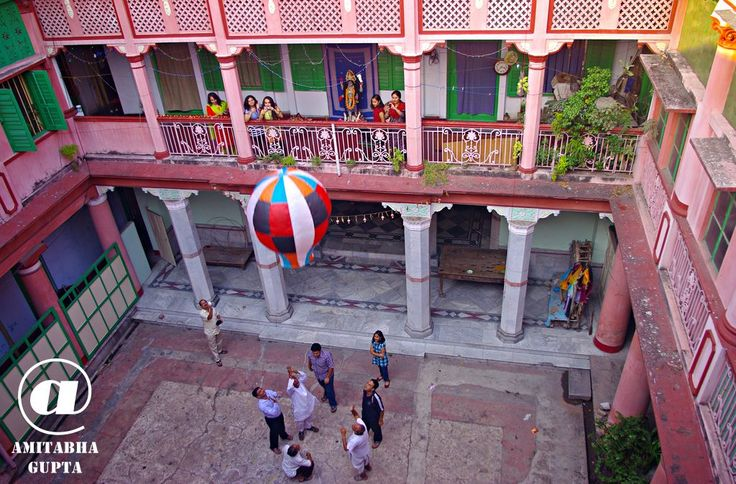 "As explained in the earlier photo, Rich families of Kolkata use to release  small hot air baloons called ""Fanoosh"" on Deepavali - the festival of lights and Kali Pujo. Today only a handful of such houses releases Fanoosh. It is released either from the terrace ( as shown in the earlier picture) or from the courtyard inside the house.   (c)Amitabha Gupta Unauthorized use or reproduction for any reason is prohibited. Please contact me personally for any use of this photograph"
