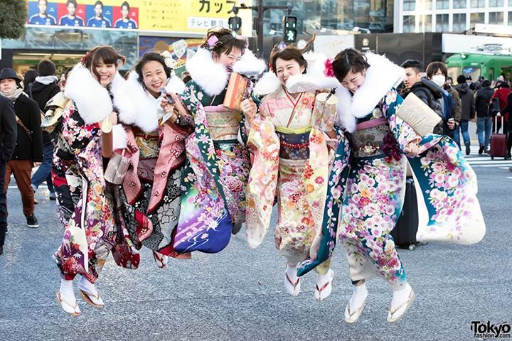 A group of Japanese friends celebrating Coming of Age Day 2015 in Japan with a big jump in the middle of the famous Shibuya Scramble! (Tokyo Fashion, 2015)