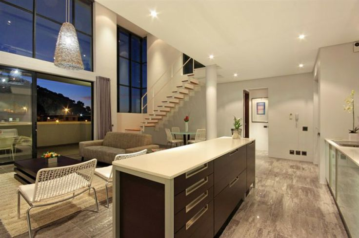 See the cityscape and the popular Lions Head through the glass-fronted living room.