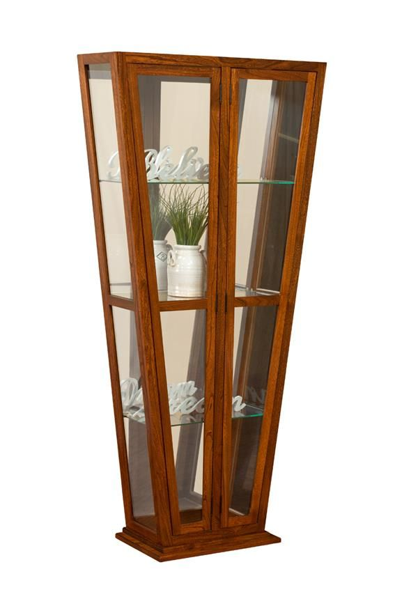Amish Melody Contemporary Curio Cabinet  Mt. Eaton Collection  Our Melody Curio Cabinet has a beautiful sleek, contemporary and unique design.  This curio cabinet comes with a tube light to show off your wonderful items kept inside.