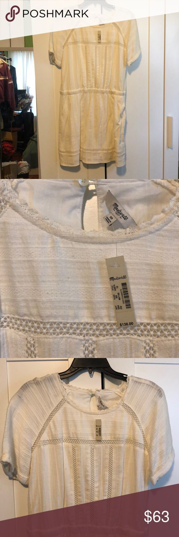 White madewell dress with pockets unworn size 10 Beautiful never been worn madewell dress size 10. Can be worn casual or to any event. Still has the tag. Below the knee dress with pockets and beautiful detail and embroidery. Elasticated waistband, runs big. Madewell Dresses