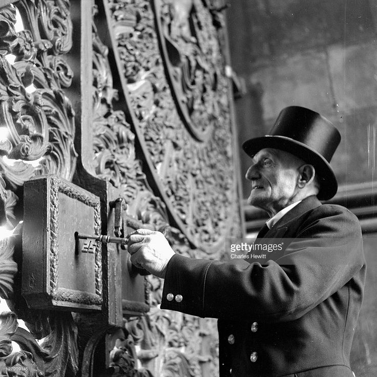 Bertram Turp opening the gate at Wellington Arch, London. He served in the 1st Royal Dragoons for 21 years before becoming a gatekeeper in the Royal Parks. Original Publication: Picture Post - 6534 - How Will You Spend The Day? - pub. 1953 (Photo by Charles Hewitt/Picture Post/Getty Images)