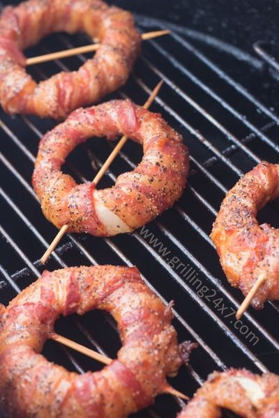 Bacon wrapped onion rings: Grill the onion rings for about 90 minutes or until the bacon looks cooked. Just keep in mind that the longer it stays on the grill, the sof...