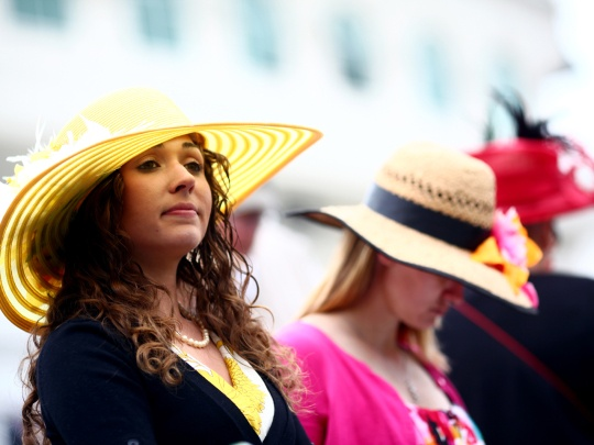 Horse racing fans show their Derby hats at the paddock in Churchill Downs before the 137th running of the Kentucky Derby in Louisville, Ky., on May 7, 2011.