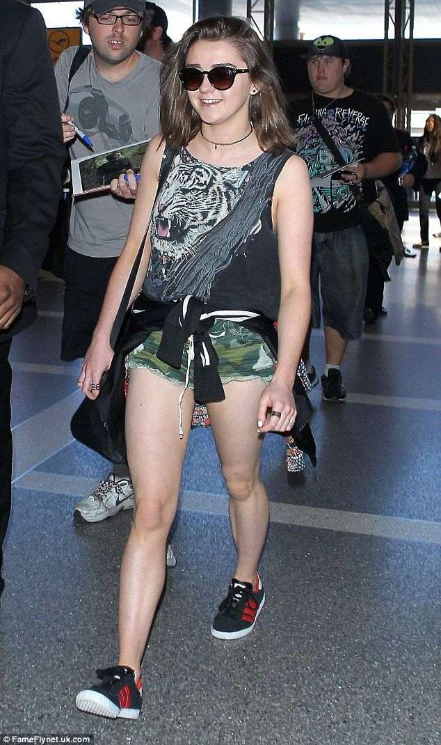 Wild thing! Maisie Williams at LAX airport in a summery outfit made up of a Tiger tank top and camouflage shorts