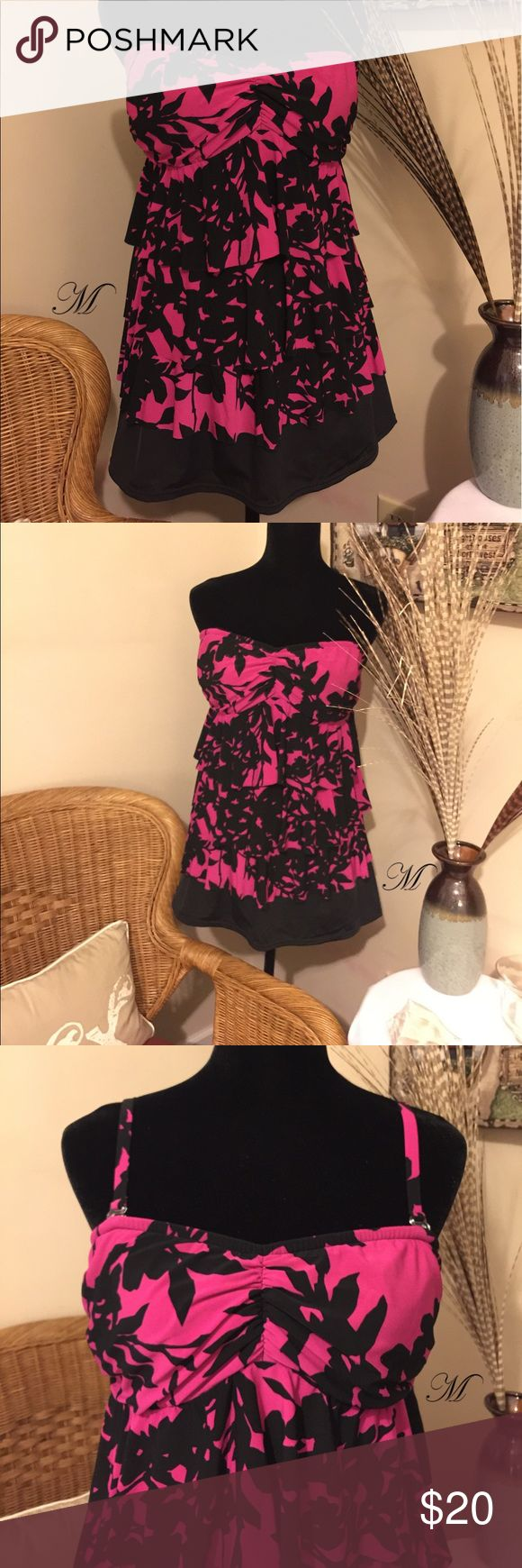 Knockout Pink Tankini This pink tankini looks great on any body type. The color is a knockout shade of pink. I received compliments every time I've worn it. It's still in great condition and has a few seasons left. It comes with removable straps. Aqua Green Swim Bikinis