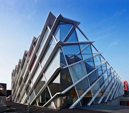 metal lozenge wire mesh facade cladding LEVIS STORE Stahlbau Pichler