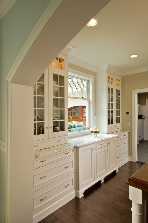 Snowbound (cabinets) and Canvas Tan (walls) by Sherwin-Williams.