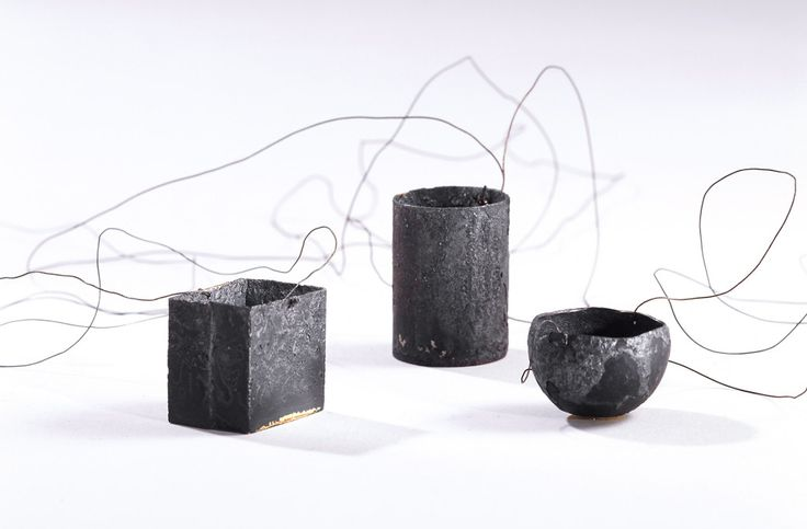 """""""To take out of the fire"""" by Kay Eppi Nölke. 1998-2004. Iron, filled with 5 g 900 yellow gold, Ø 2,4 cm, 12 g 925 silver, 1,8 × 1,2 × 1,2 cm, 12 g 750 yellow gold, Ø 2,2 × 3 cm."""