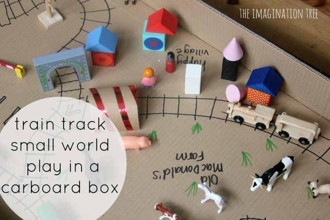 Cardboard tunnels, cereal box train station and train tracks drawn in a giant box! Turn a cardboard box into a giant small world play scene, with drawn on train tracks and play elements made from everyday recycled materials. This is the perfect rainy afternoon fun set up and encourages creativity and imaginative play.