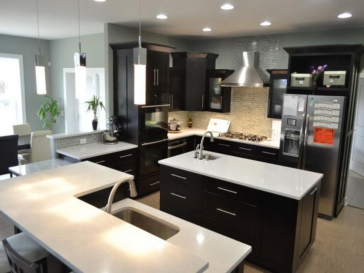 Best White Quartz Countertops On Dark Wood With Silver Handles 640 x 480