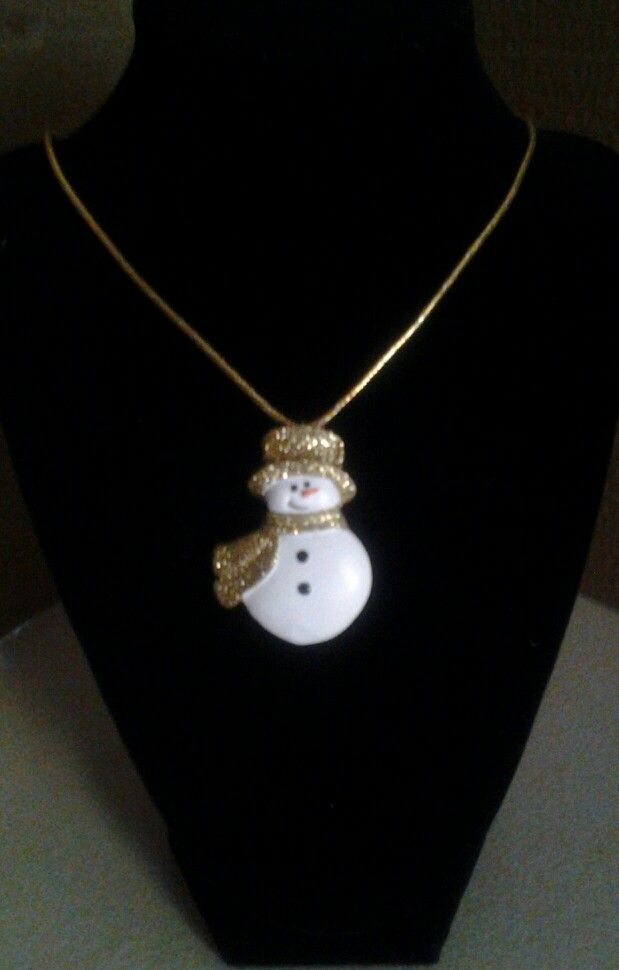 Snowman with a gold hat and scarf on a gold cord