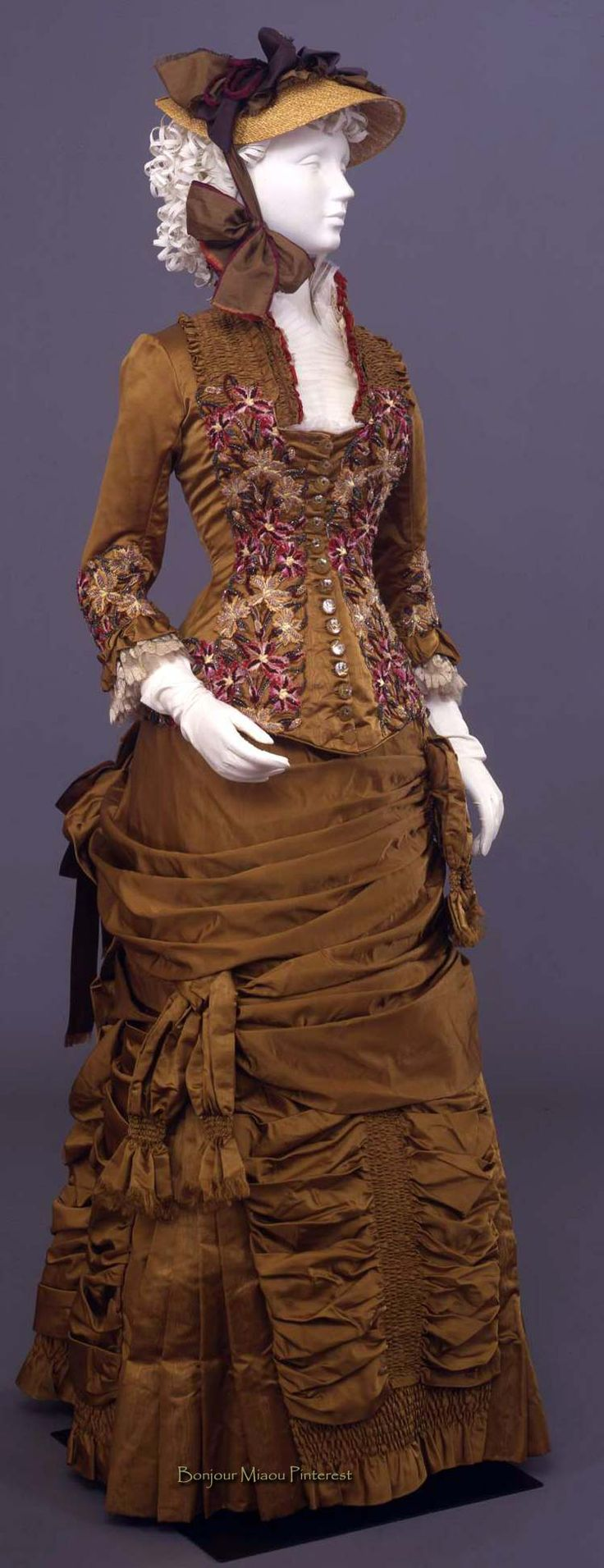 "Two-piece ensemble, Giabbani, Florence, ca. 1881. Ocher yellow silk satin and moiré embroidered in multicolored silk and turquoise beads and trimmed with organza ruffles and blonde lace. Closes with 15 glass buttons. ""Cloche""-type skirt. Costume Gallery of Palazzo Pitti via Europeana Fashion"