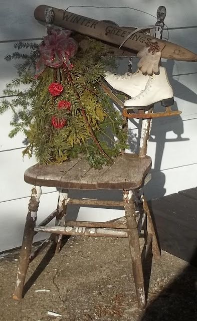 Pair of Ice Skates and Rustic Smell of Pine Hanging From a Vintage Wooden Chair in Winter