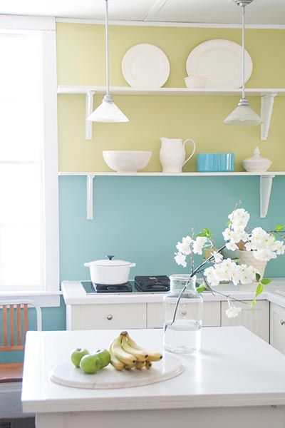 Paint wainscot or lower half of wall a shade or two darker than the upper portion.We like Olympic's Lemon Mint for upper walls and South Pacific for lower walls, about $28 per gallon; at Lowe's stores.Get more fun paint ideas from our favorite colorful kitchens.
