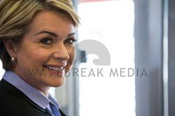 Smiling businesswoman standing at airport