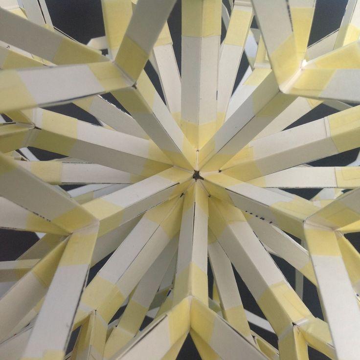 Hypothetical crystal pattern. Sliced milk cartons. Splitting rhombi.