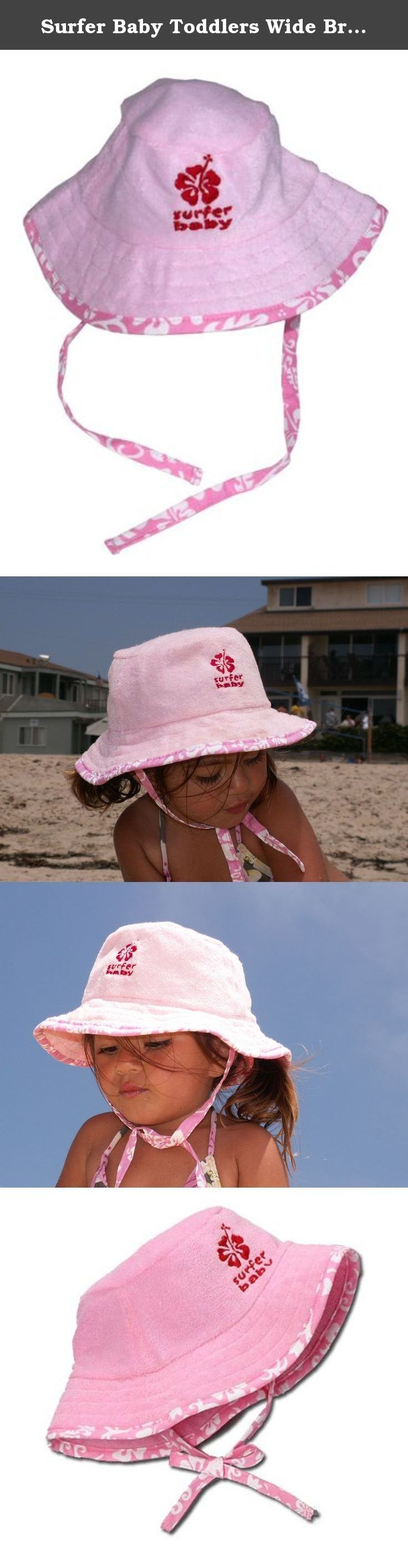 Surfer Baby Toddlers Wide Brim Kids Floppy Beach/Sandbox/Play Sun Protection Bucket Hat (Pink). This is a 100% cotton terry cloth floppy sun protection hat, lined with cotton, and trimmed in our Surfer Baby aloha print with matching ties to secure the hat under the chin. Perfect for the beach, sandbox, park, in the car, any time you want to keep your little one's face protected from sunburn! Pink with a matching embroidered Surfer Baby logo. One size fits most toddlers 12-36 mos.