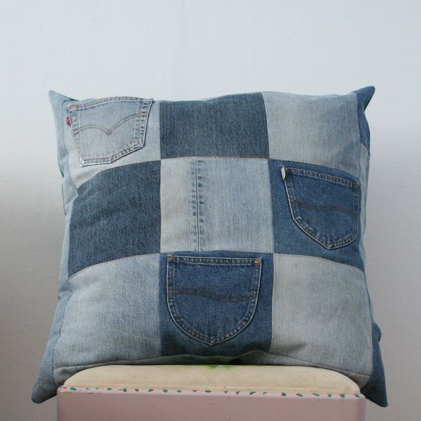 Another jeans idea.....Jeans Pillow  (note: the site is not in English and translates weird...but this looks pretty basic)