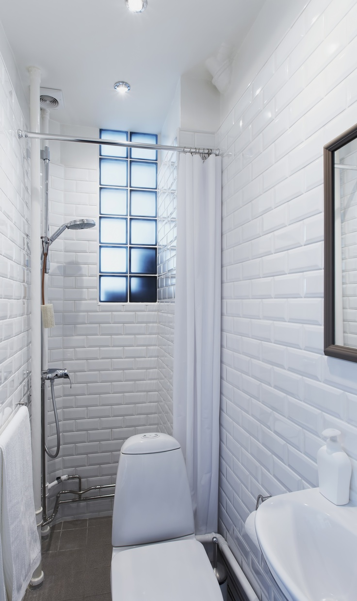 Small Bathroom with Paris Metro-style tiles on walls