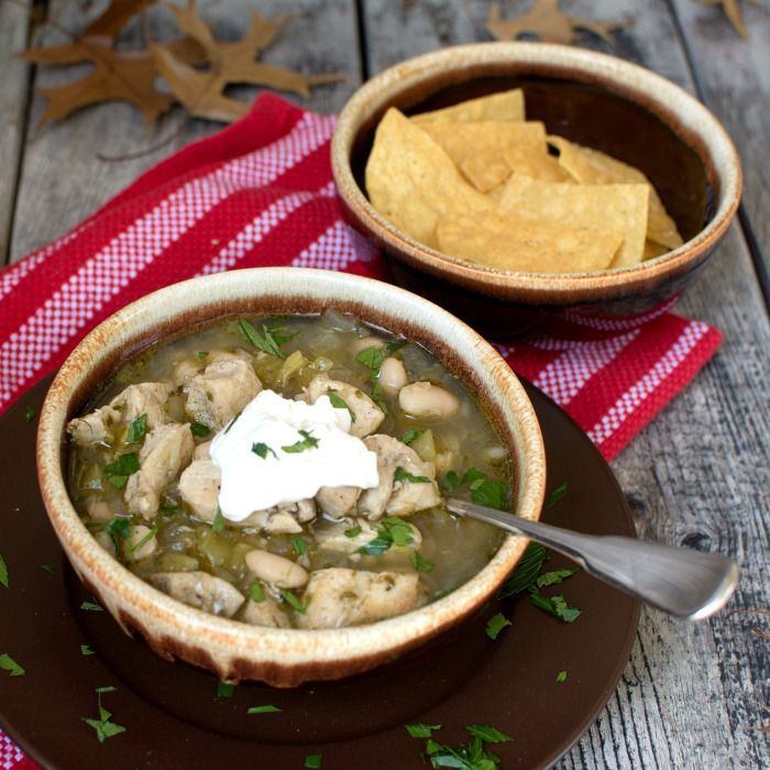 Wickedly Good Spicy White Chicken Chili is filled with juicy chicken, creamy white beans and topped with a touch of lime and a dollop of sour cream