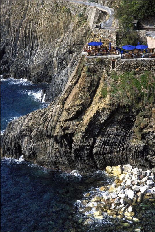 Cliff-side cafe, Cinque Terre, Italy I have been here!! That was one of my best mornings ever :)