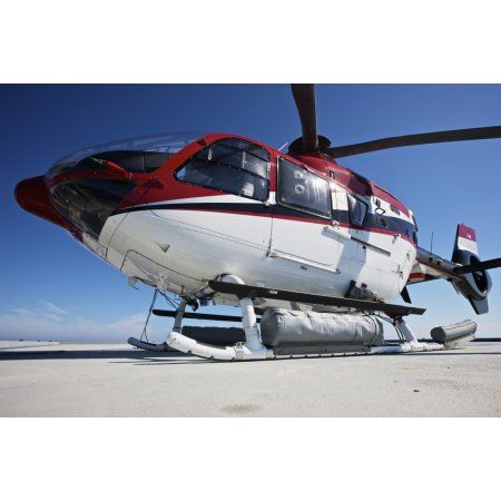 Eurocopter EC135 utility helicopter on the helipad of an oil rig Canvas Art - Terry MooreStocktrek Images (18 x 12)