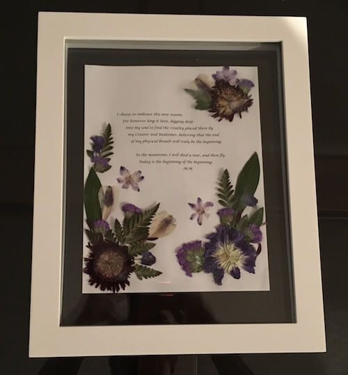 Framed picture of dried flowers and blog quote
